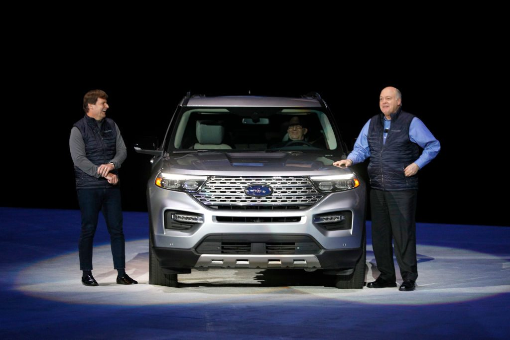 Jim Hackett (R), president and CEO of Ford Motor Company, and President of Global Operations Jim Farley speak at the reveal of the new 2020 Ford Explorer SUV at Ford Field