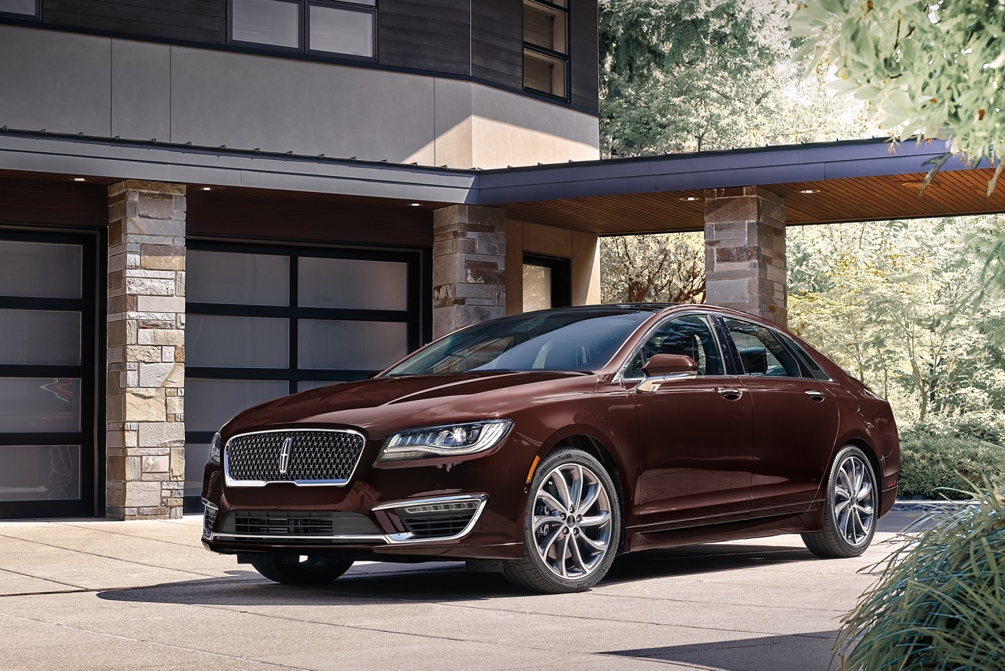 a Lincoln MKZ parked in front of an upscale modern home is an example of a car with the worst resale value