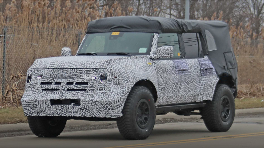 A testing mule for the 2021 Ford Bronco wrapped in camouflage