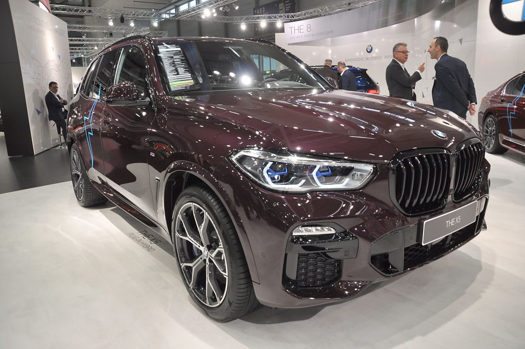 A BMW X5 on display at an auto show