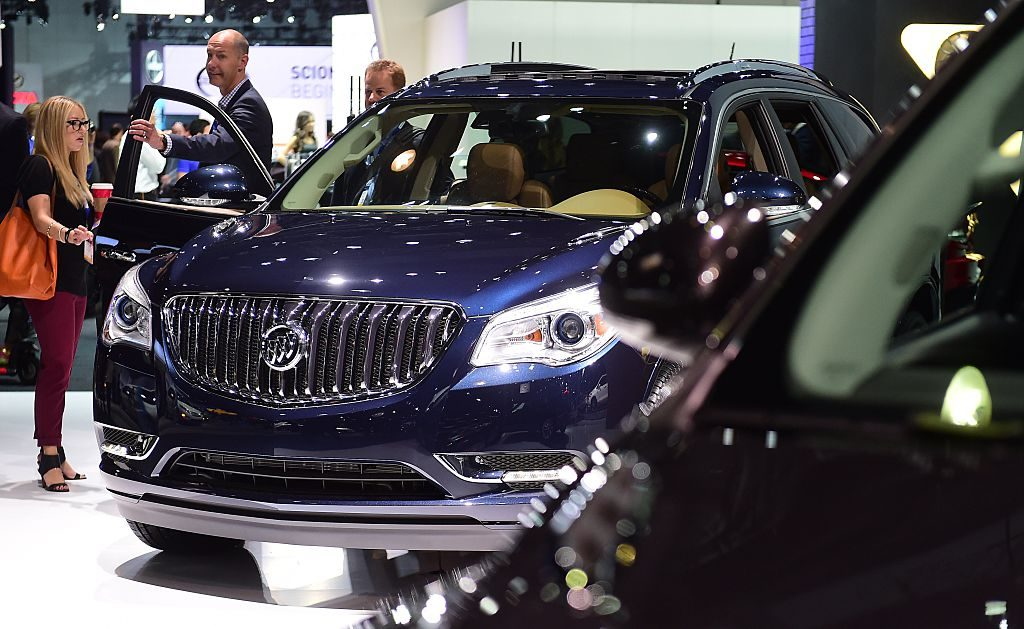 People inspect the 2015 Buick Enclave on display at the LA Auto Show's press and trade day in Los Angeles, California on November 19, 2014