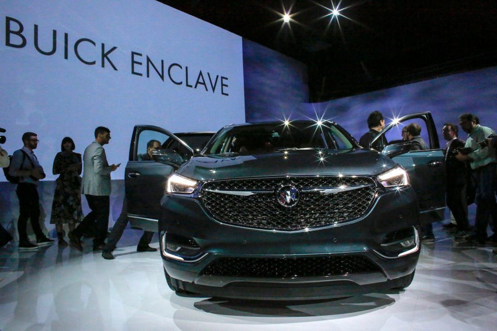 People watch the new Car Buick Enclave Avenir after it was revealed on April 11, 2017 in New York