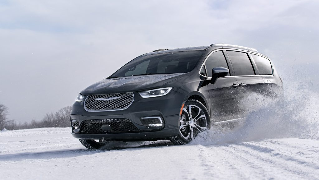 Dark gray 2021 Chrysler Pacifica with AWD drifting through the snow