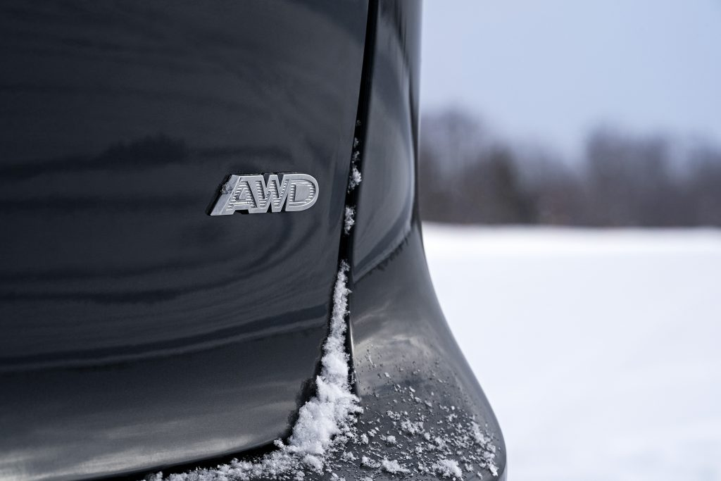 the AWD insignia on the back of a black Pacifica minivan
