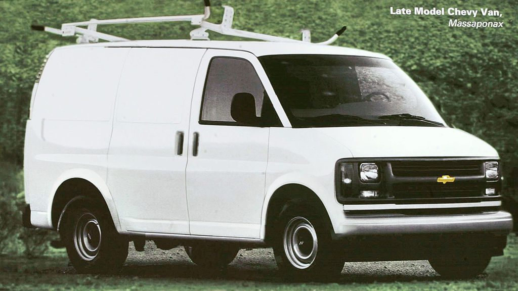 A Chevy Astro van in a parking lot