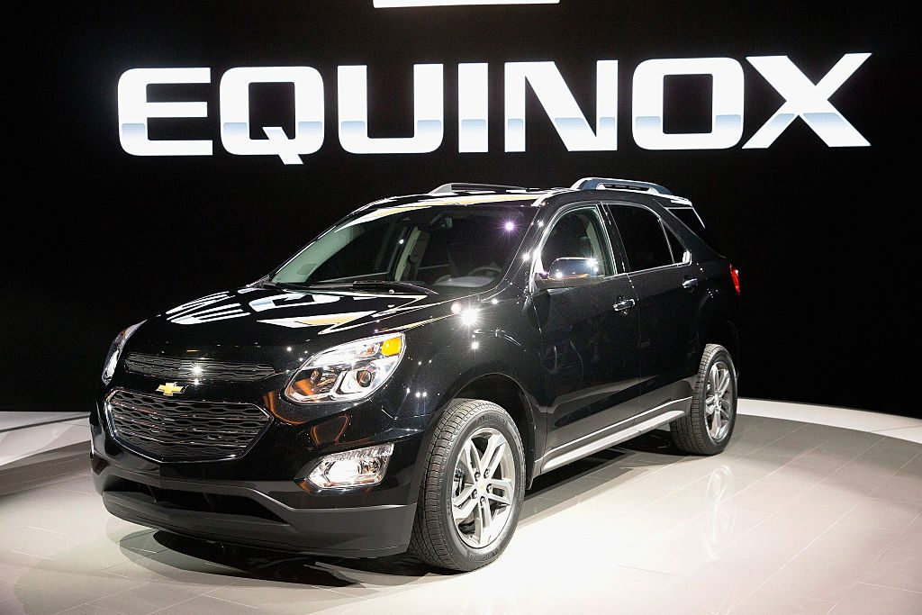 A black Chevy Equinox on display at an auto show