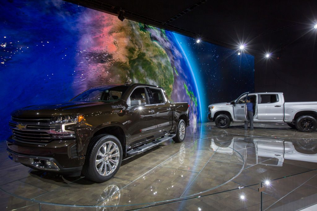 A man looks at a Chevrolet Silverado truck at the auto trade show, AutoMobility LA, at the Los Angeles Convention Center