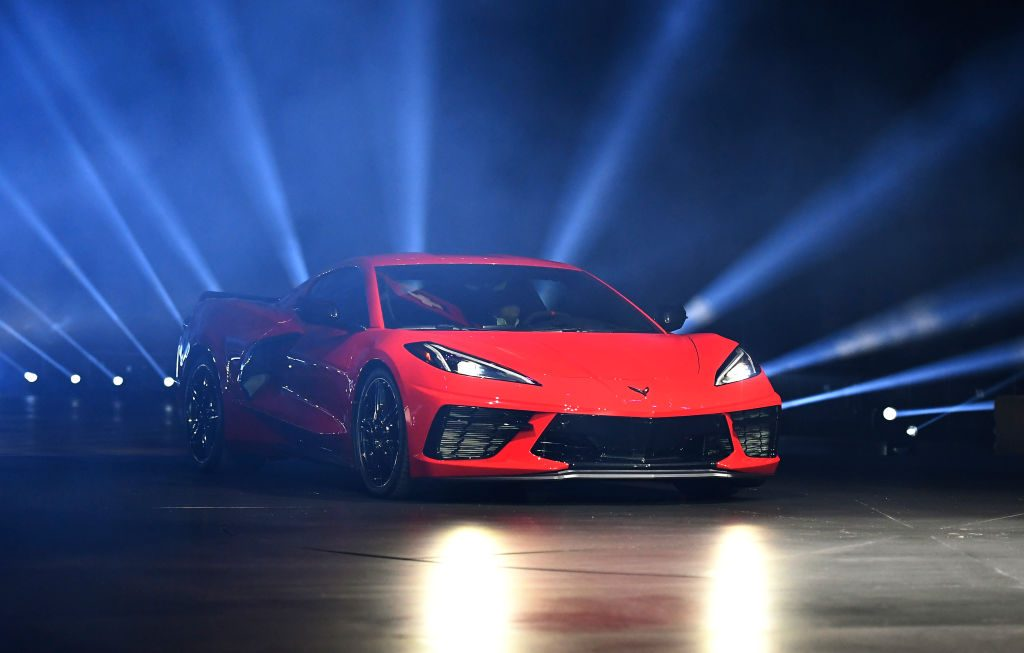 Red C8 Corvette on stage with rays of light