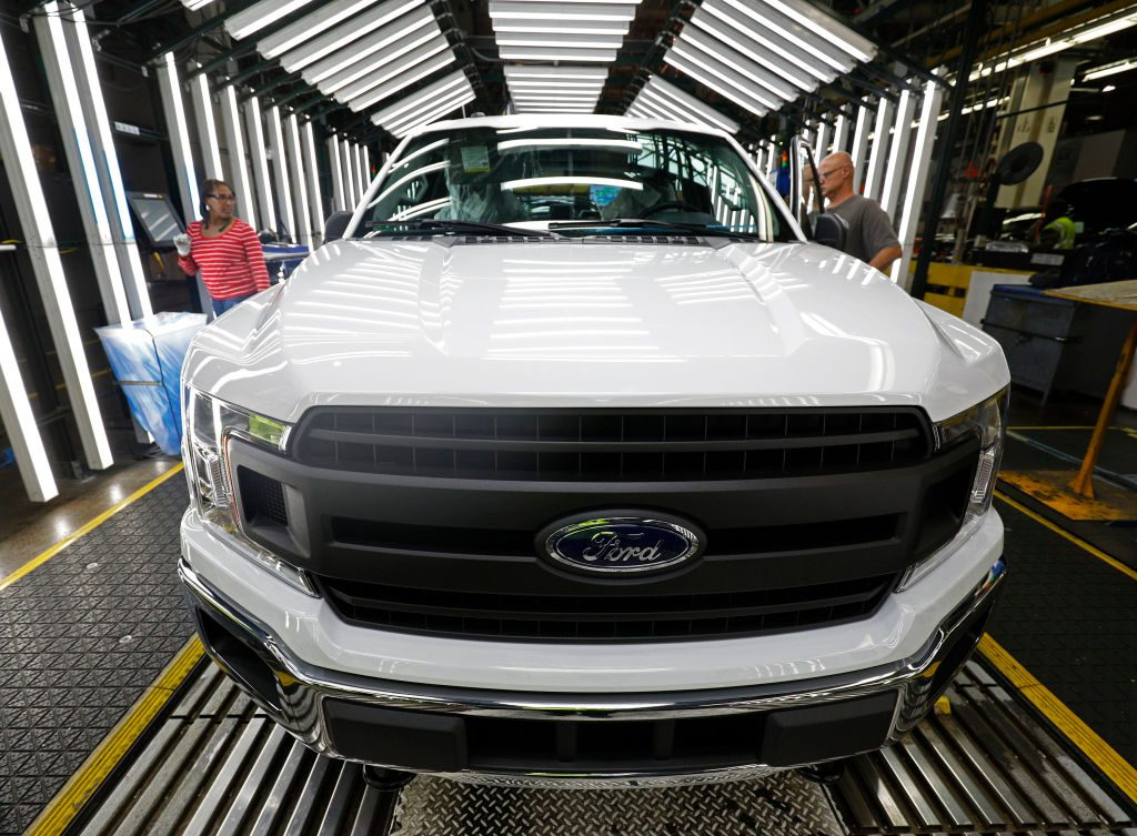 Ford F-150 trucks go through the customer acceptance line at the Ford Dearborn Truck Plant on September 27, 2018