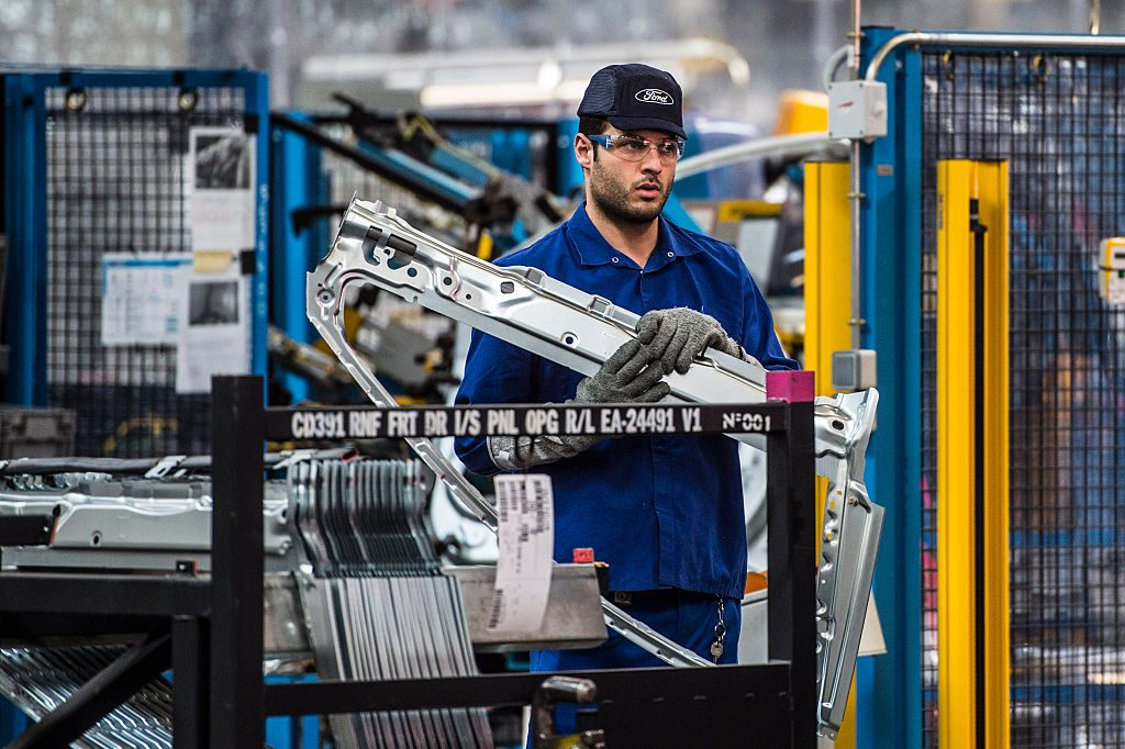An employee works on Ford Mondeo vehicles on the production line during assembly at Ford plant in Almussafes