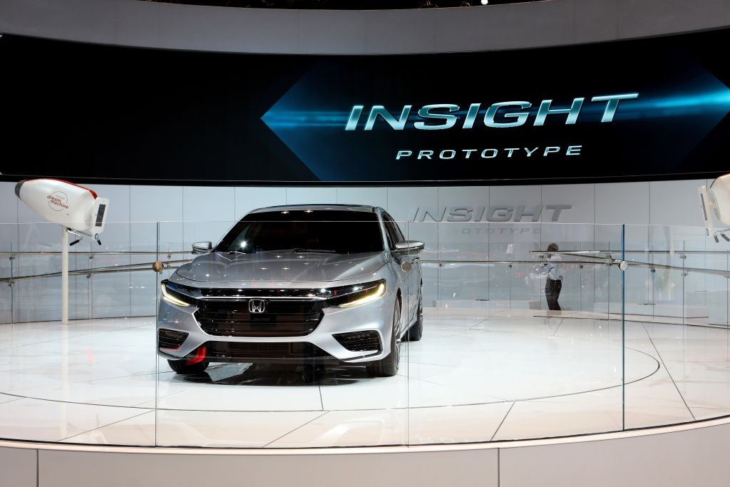 A Honda Insight on display at an auto show demonstrates great hybrid sedan that is also one of the best 2021 models under $30 grand