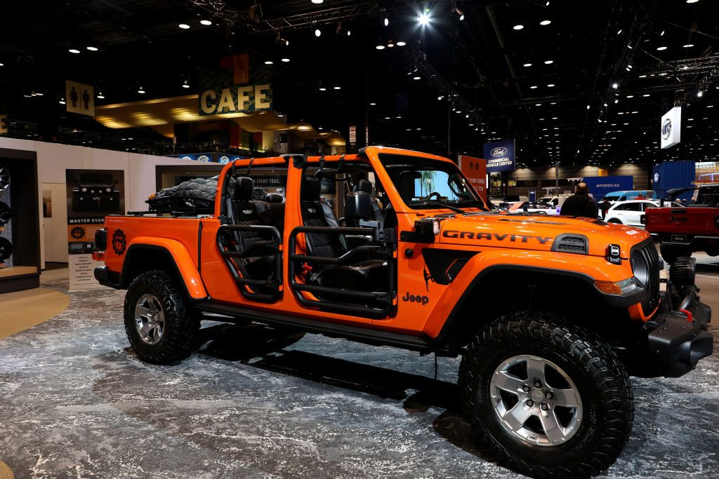 A 2020 Jeep Gladiator on display at an auto show