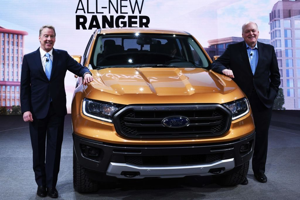 Bill Ford (L), executive chairman of the Ford Motor Company, and Jim Hackett (R), President and CEO, pose with the 2019 Ford Ranger