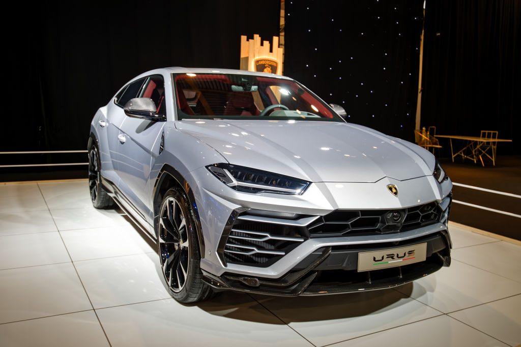 A new Lamborghini Urus on display at an auto show