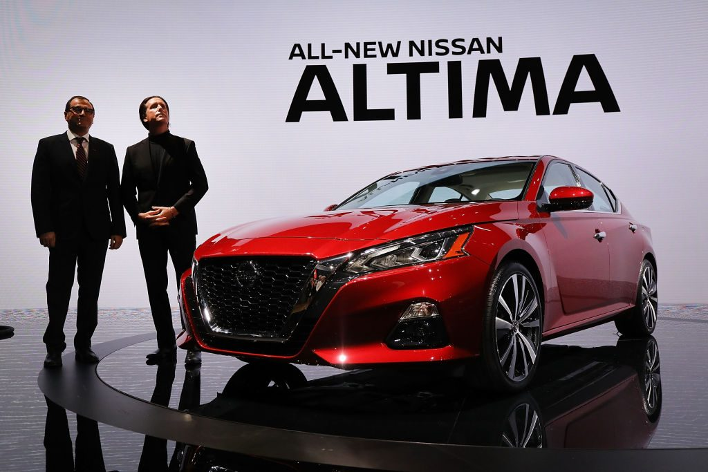 Denis Le Vot (left), the new chairman of Nissan North America and Alfonso Albaisa, senior vice president, Global Design, stand beside the 2019 Nissan Altima sedan at the New York International Auto Show