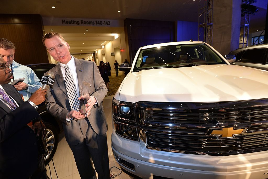 Chief Engineer of GM's full and mid-size trucks, Jeff Luke(C) accepts the North American Car and Truck of the year award for the Silverado truck, January 13, 2014 at the 2014 Detroit Auto Show