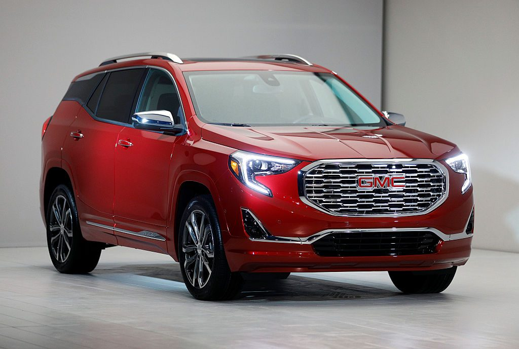 A red GMC Terrain on display at a car show