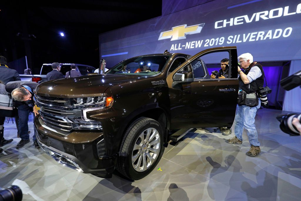Journalists check out the new 2019 Chevrolet Silverado 1500 after its official debut at the 2018 North American International Auto Show