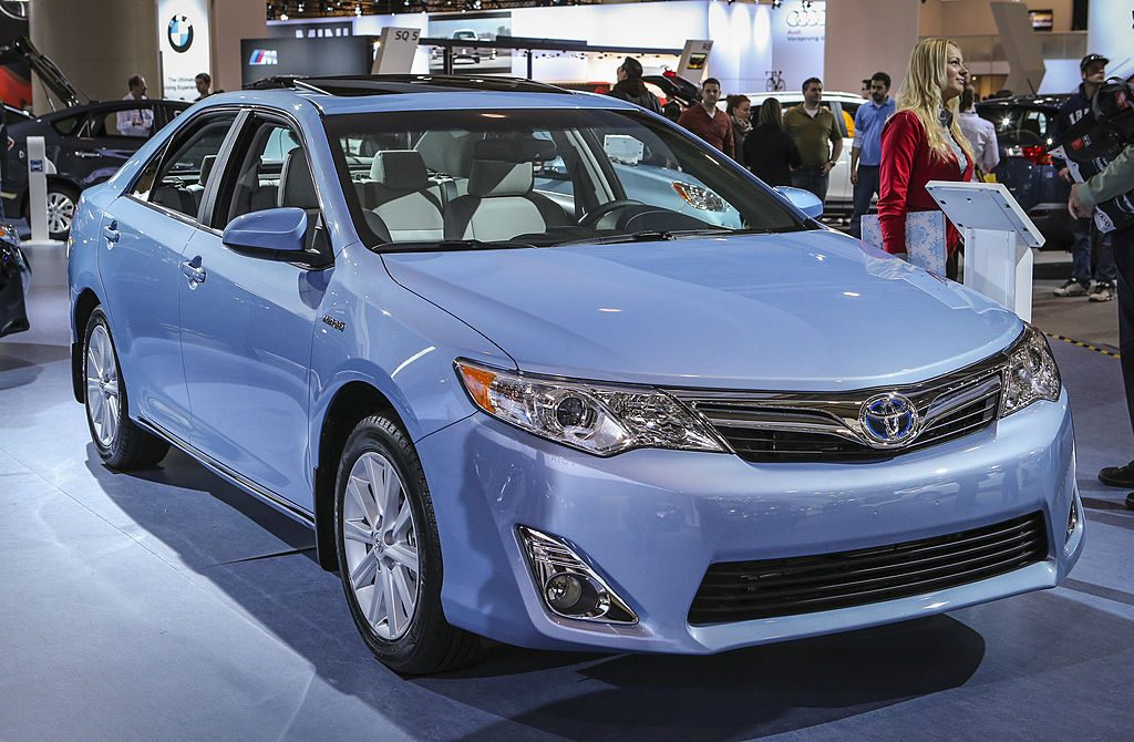A Toyota Camry on display at an auto show