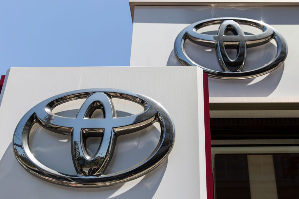 Toyota Motor Corp. logos are displayed outside one of the company's dealerships on May 8, 2019 in Tokyo, Japan