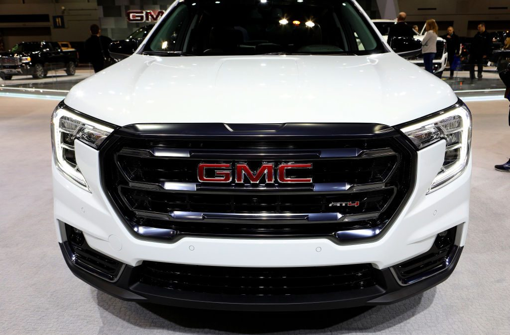 A new 2020 GMC Terrain on display at an auto show