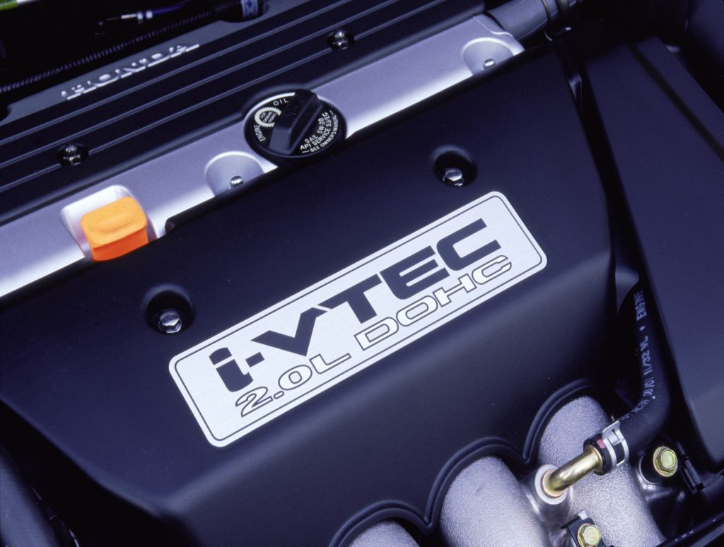 A close-up of the 2.0-liter four-cylinder engine in a 2002 Honda Civic Si.