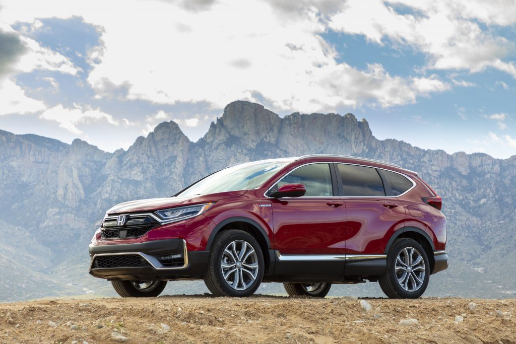 a red 2020 Honda CR-V Hybrid crossover in a mountainous landscape