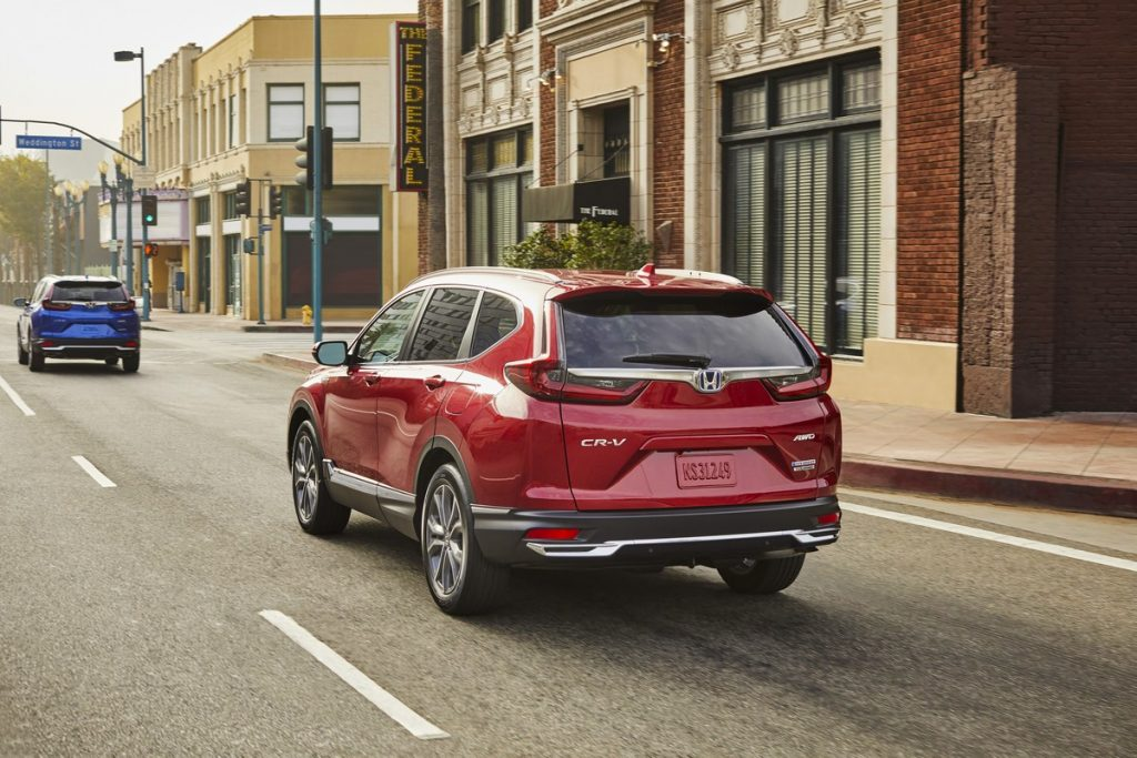 2020 Honda CR-V Hybrid in red driving on the road