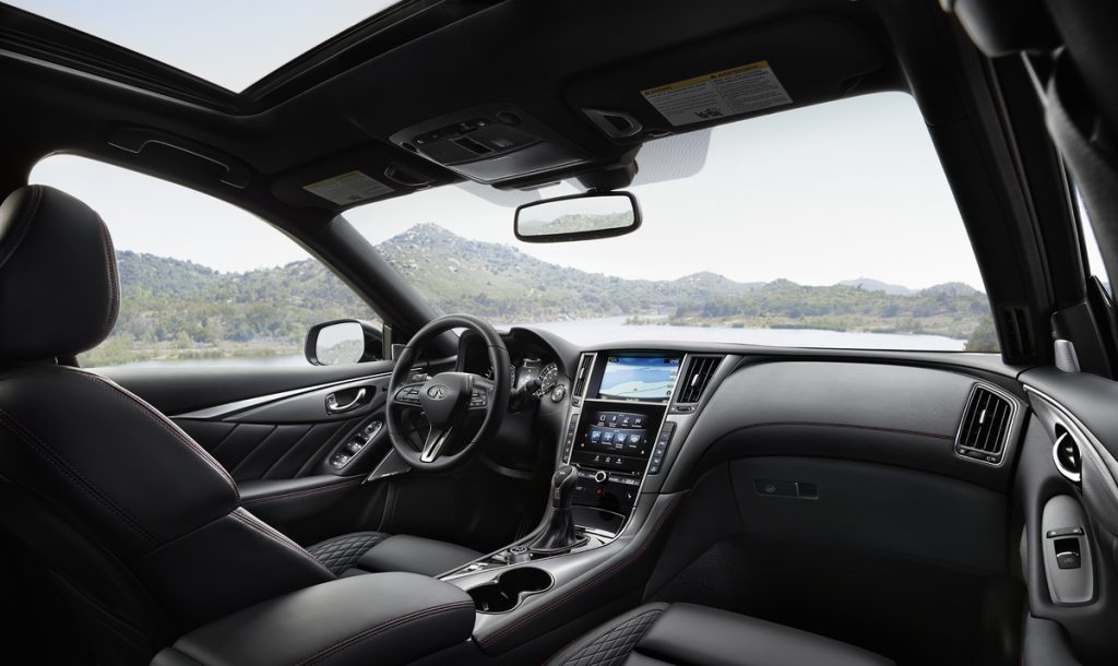 The front seats of a Infiniti Q50 sedan.