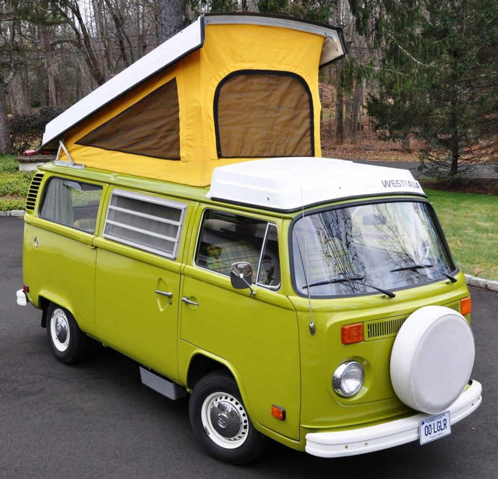 Green 1976 Volkswagen Westfalia Bus camper van with yellow pop-up roof