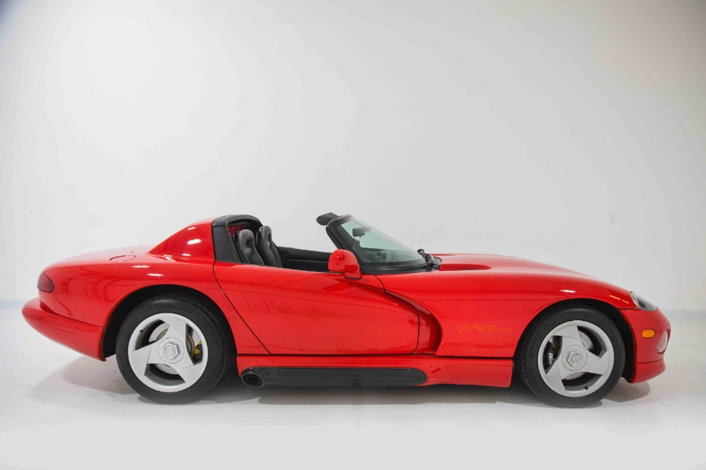 The profile of a red 1993 Dodge Viper RT/10.