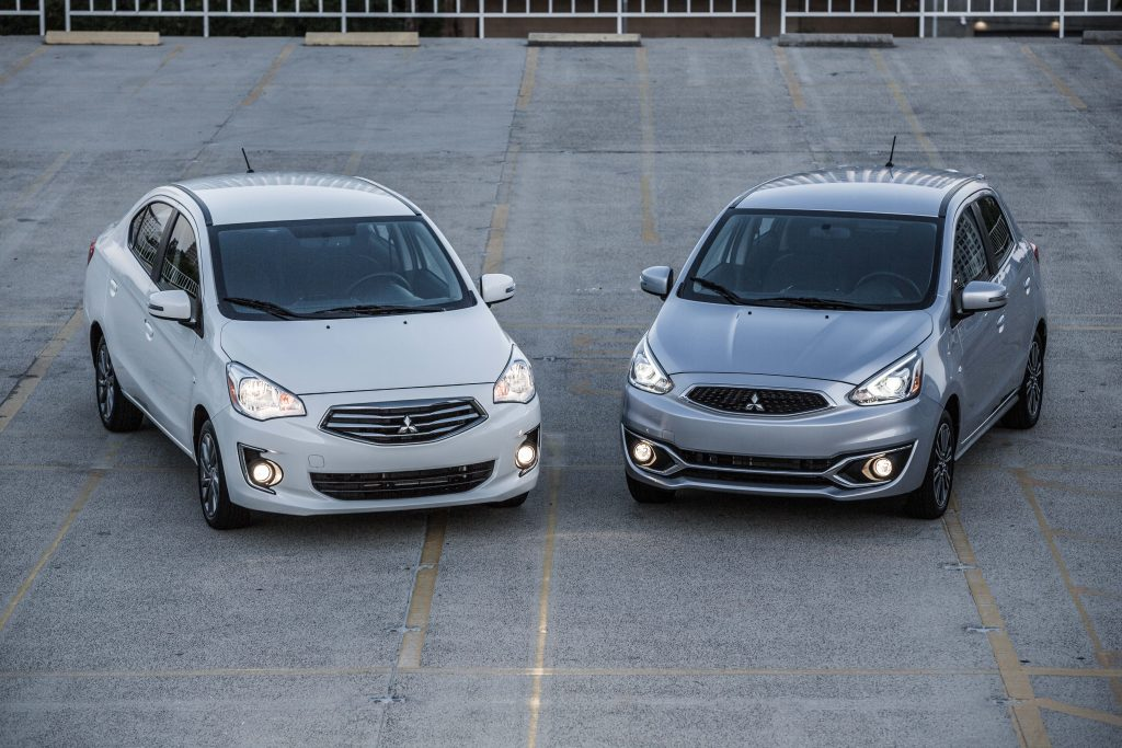 A 2020 Mitsubishi Mirage G4 sedan and 2020 Mitsubishi Mirage hatchback parked in a parking lot.
