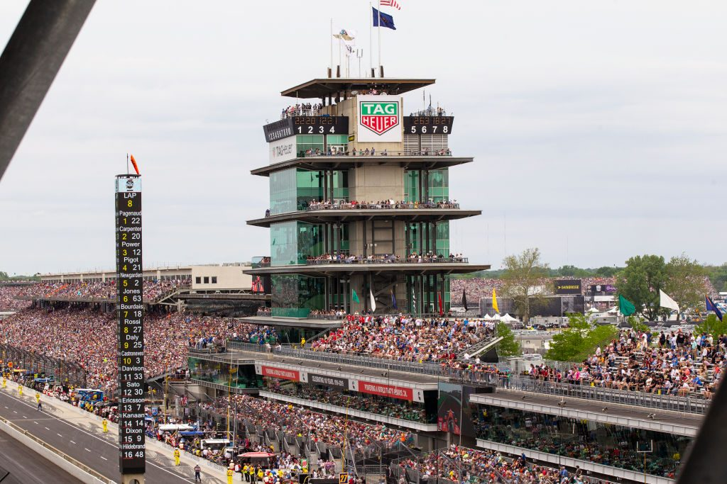 A crowd of fans attending the 2019 Indianapolis 500, filling the stands.