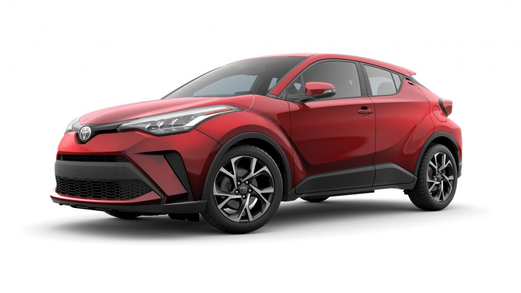 A red 2020 Toyota C-HR parked in front of a white background.