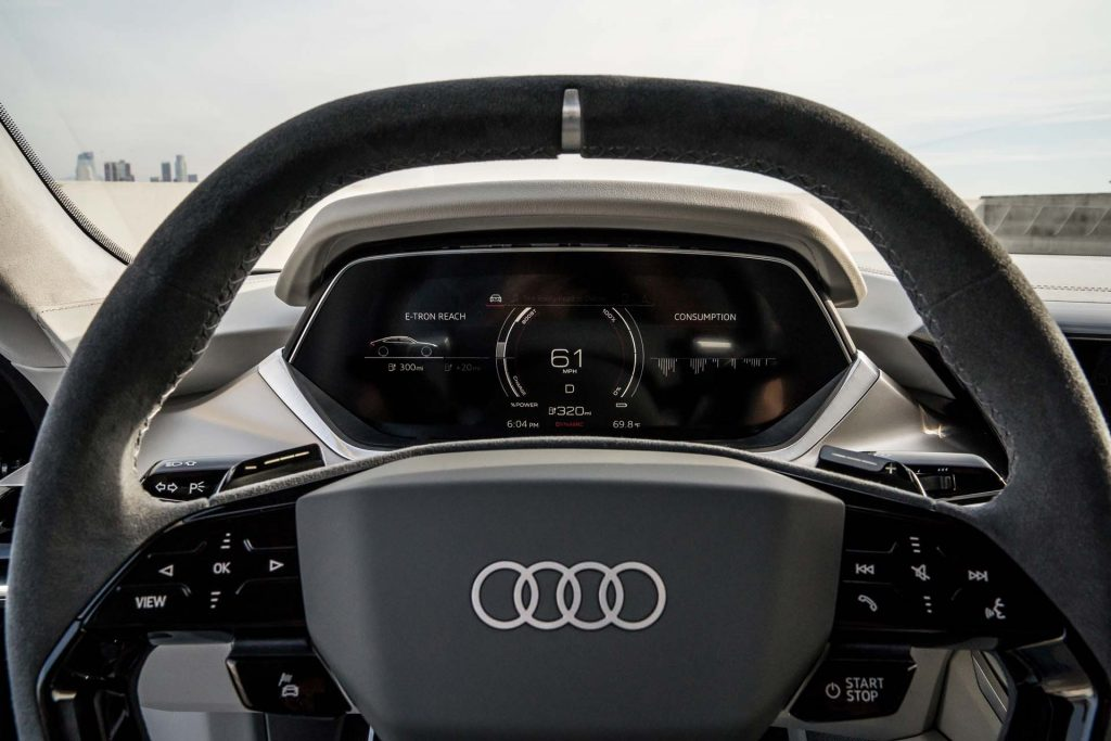 A black matte Audi e-tron steering wheel.