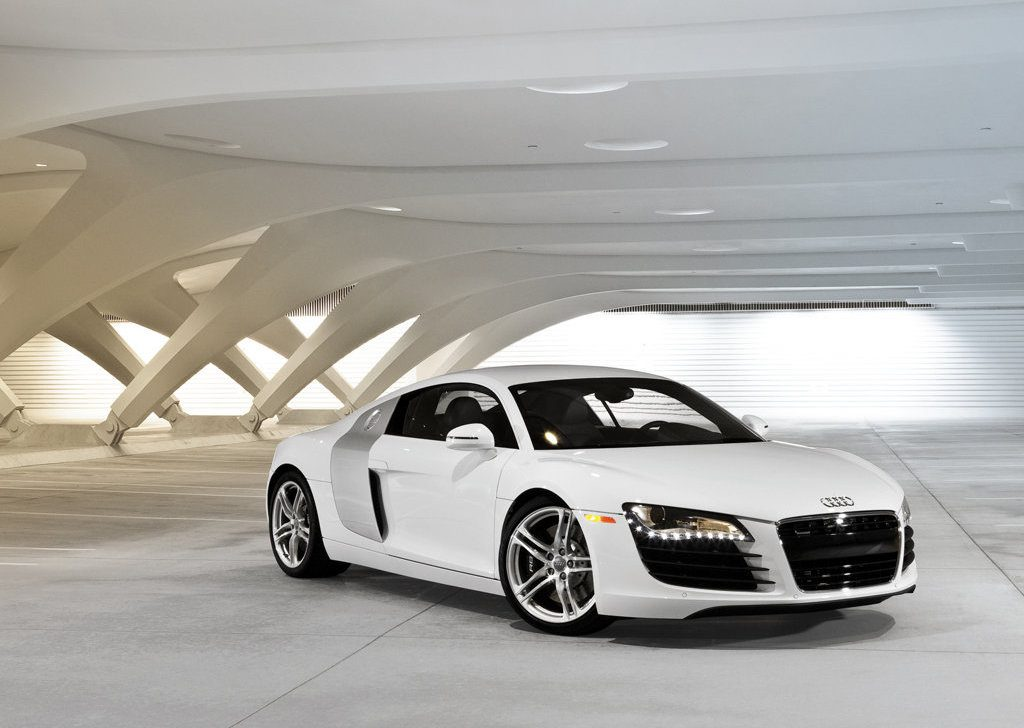 White 2008 Audi R8 in a white parking garage