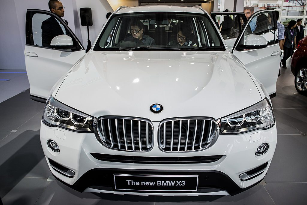 Visitors look inside the new BMW x3 at The 22st Indonesia International Motor Show