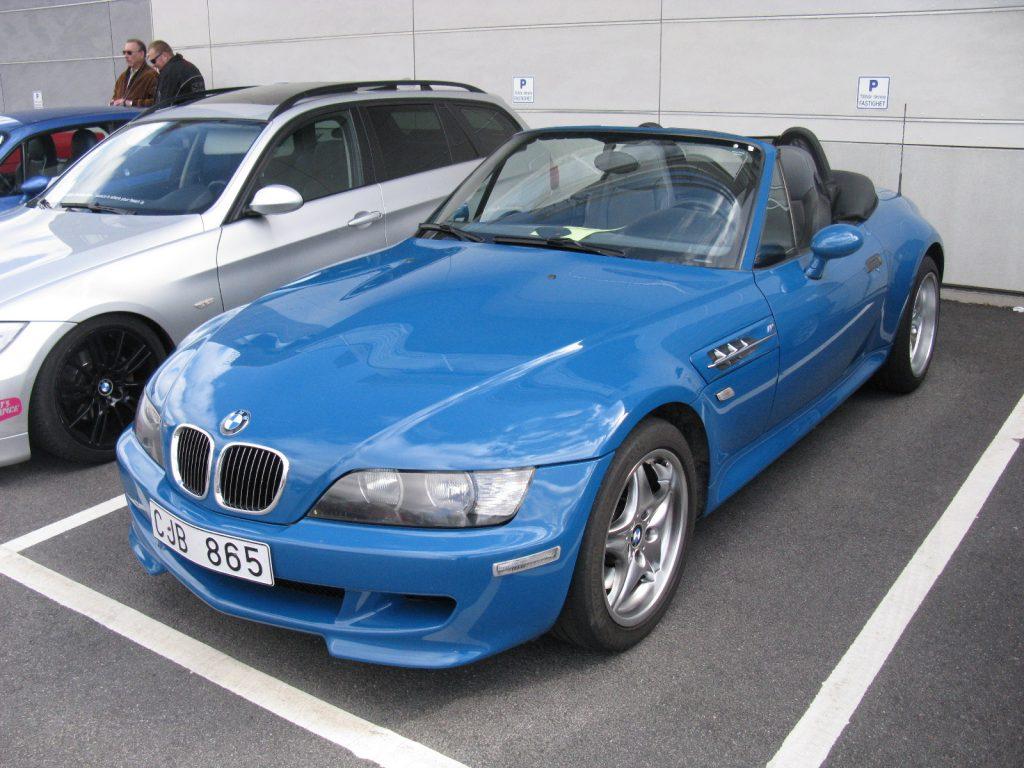 A blue 2001 BMW Z3 M Roadster parked in a parking lot.