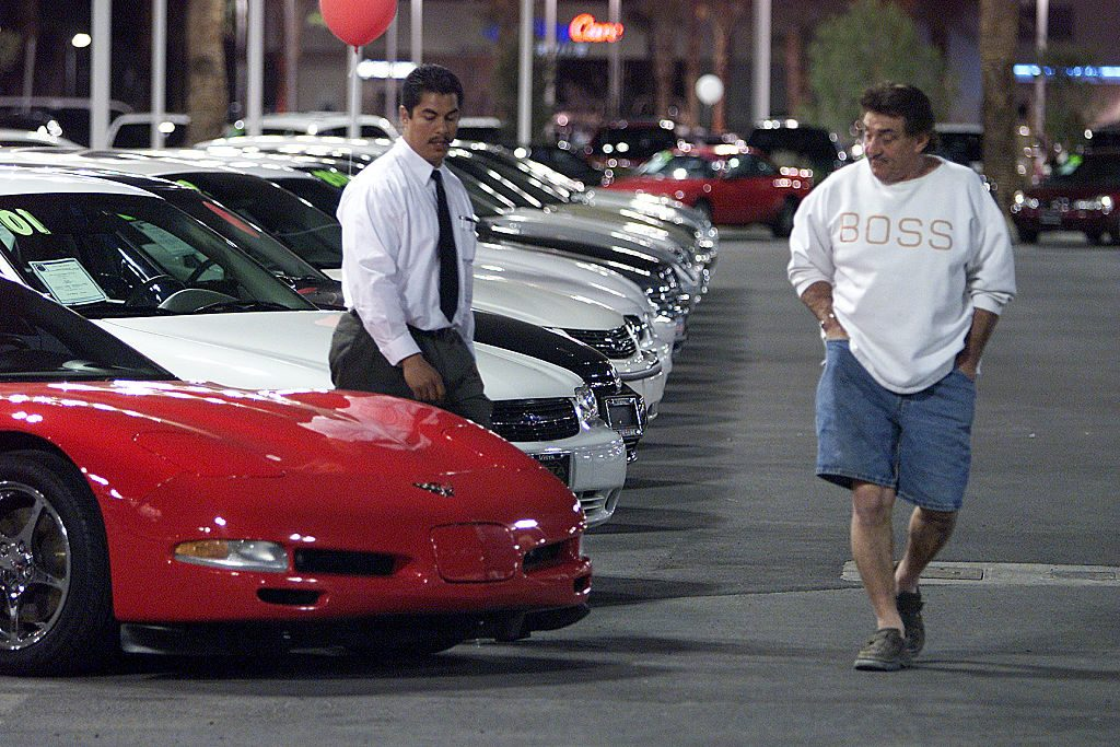 A man looking at buying a Corvette