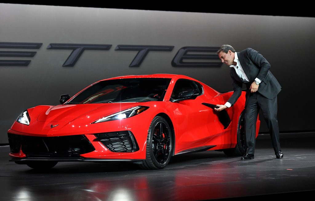 Mark Reuss, president of General Motors Company, unveils the 2020 mid-engine C8 Corvette Stingray during a news conference