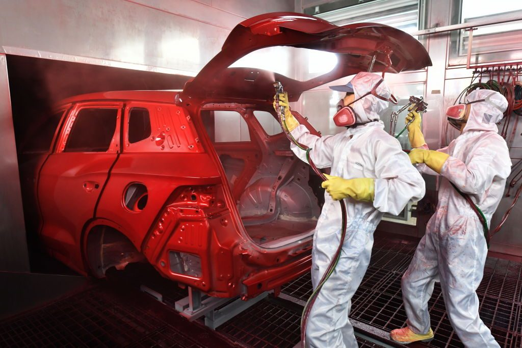 painters painting a car