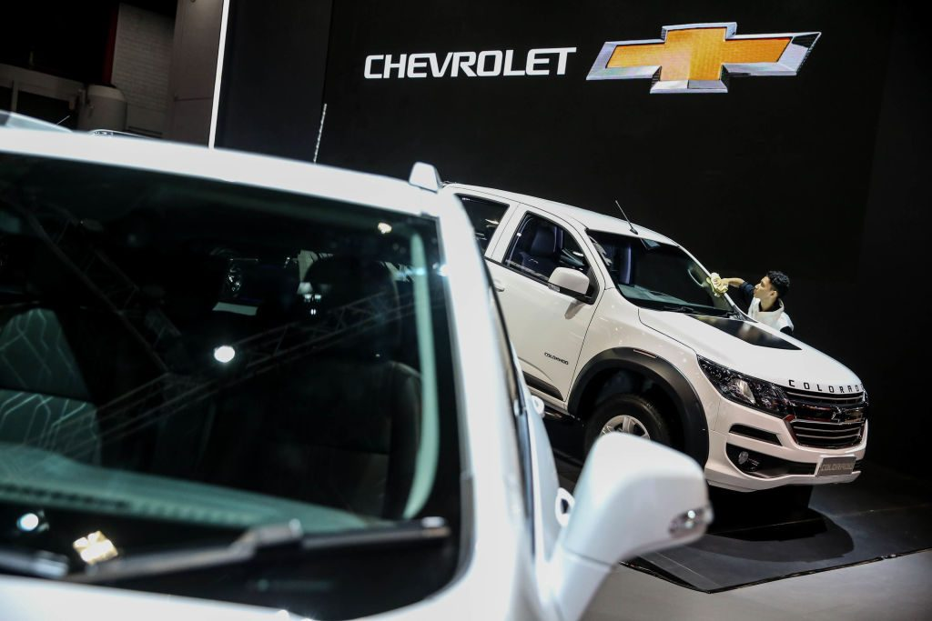 A worker cleans a Chevrolet Colorado displayed at the Indonesian International Motor Show