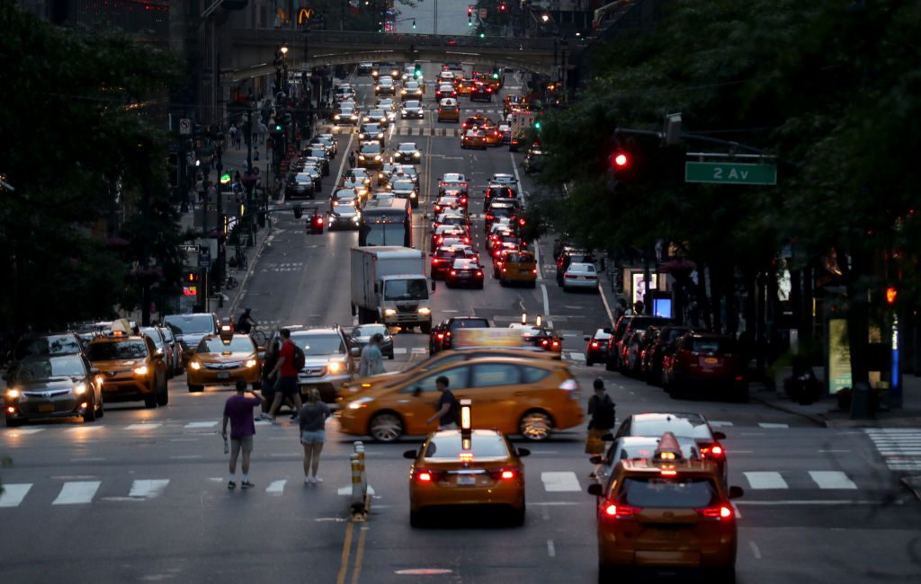 Traffic moves along 42nd Street at sunset on June 2, 2019 in New York City