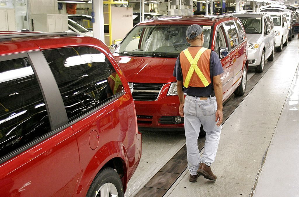 Dodge Grand Caravans being assembled in a factory