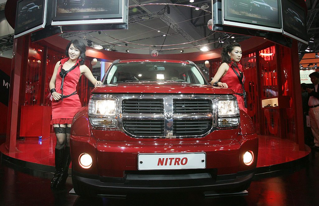 A Model poses next to a Dodge Nitro at the Seoul Motor Show 2007