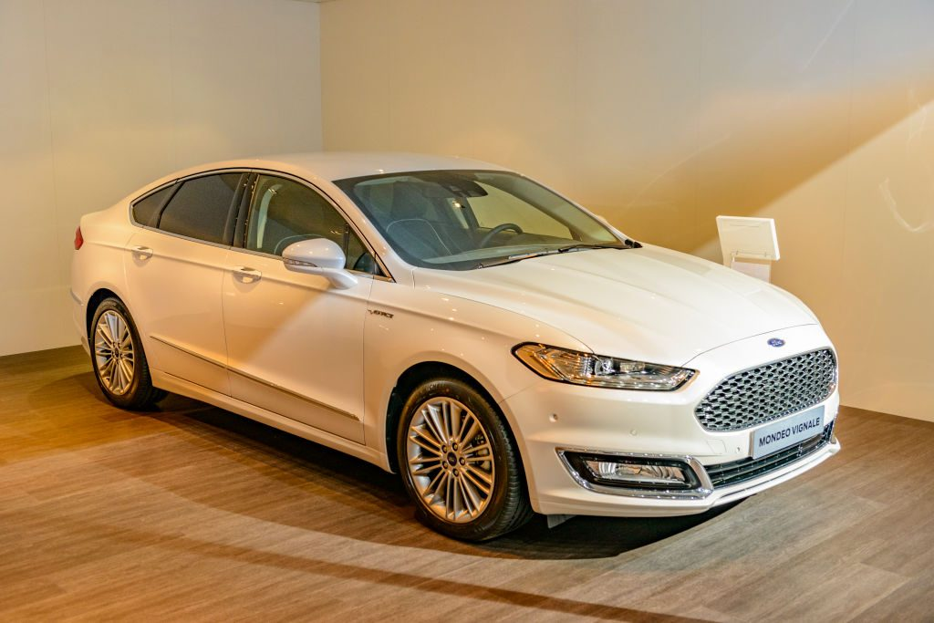 Ford Mondeo familiy car of the fith generation front view on display at Brussels Expo on January 13, 2017 in Brussels, Belgium. The Ford mondeo or Ford Contour or Mercury Mystique or Ford Fusion is available as fastback and estate car