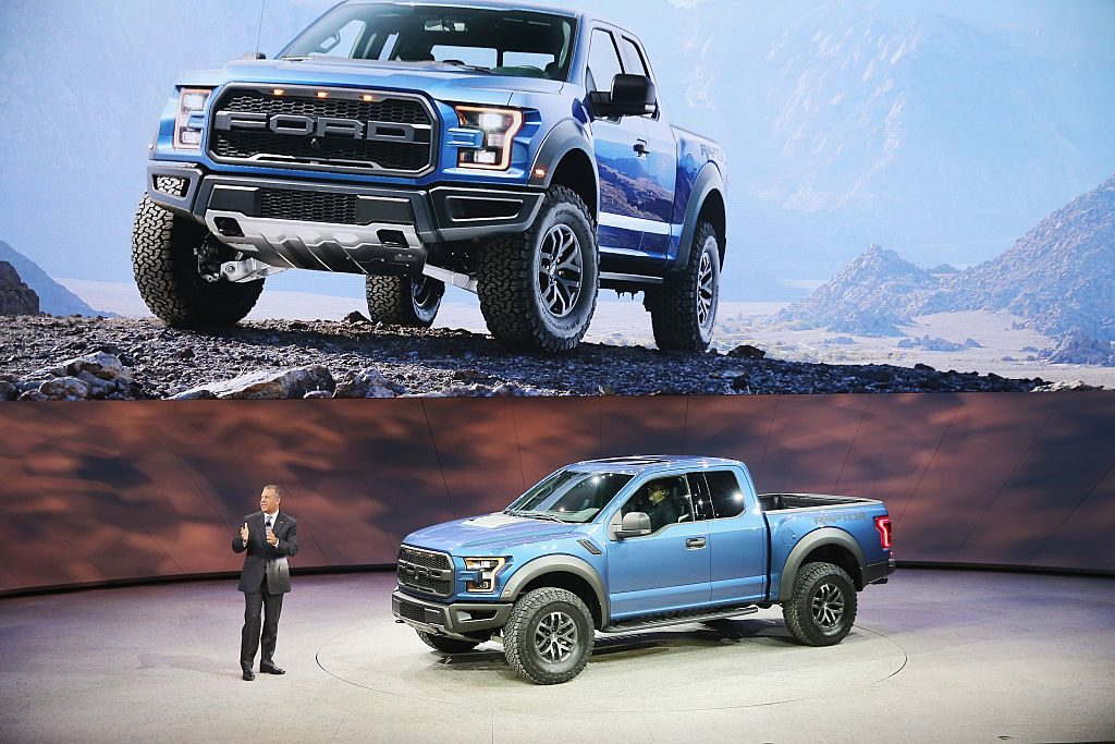 Ford Raptor being presented by a business man at an auto show
