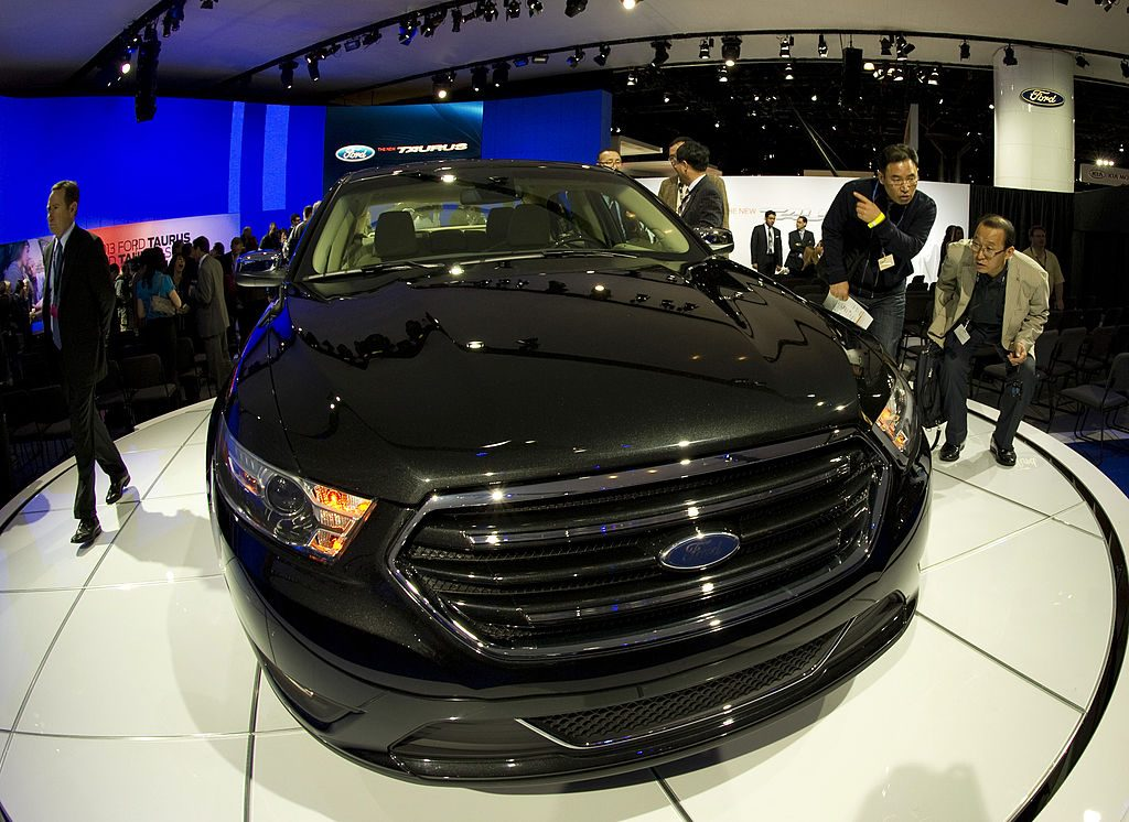 Media get a close look at a Ford Taurus April 20, 2011 during the New York Auto show
