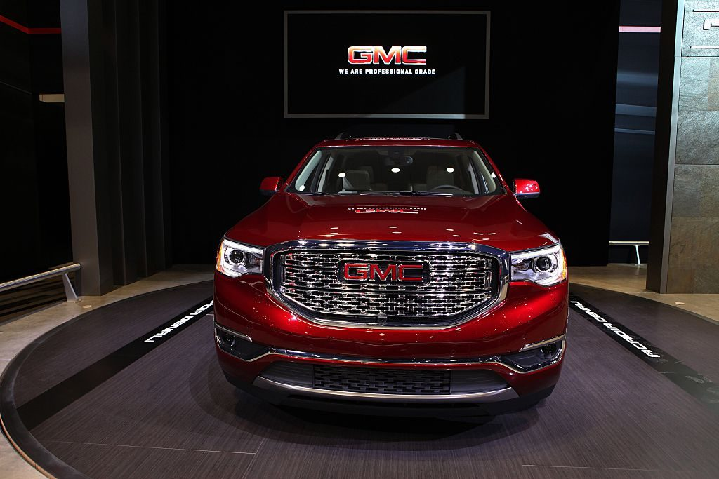 A red GMC Acadia on display