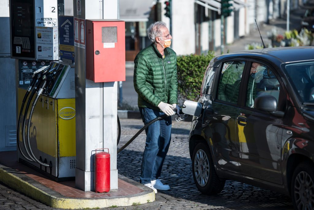 A man with mask makes gasoline from a gas station in Turin during on the Italy Extends Coronavirus Lockdown